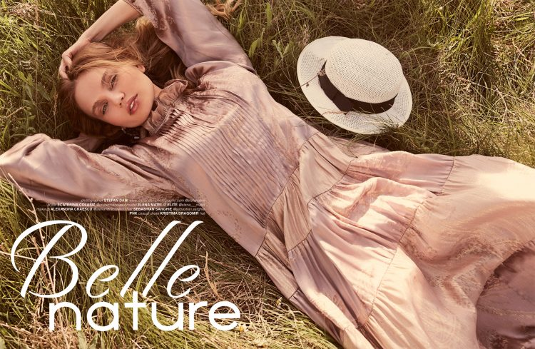 Image of model Elena Matei lying in the grass